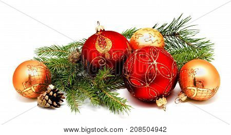 Christmas decoration red golden yellow balls with fir cones and fir tree branches isolated on a white background
