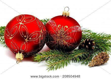 Christmas decoration red balls with fir cones and fir tree branches isolated on a white background