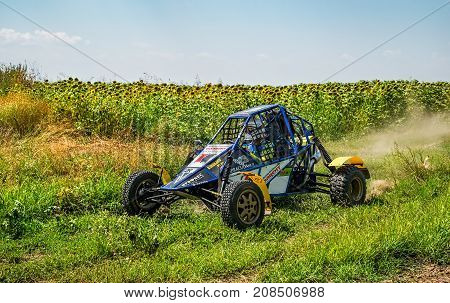 Ruse district, Bulgaria - July 21, 2017. Ivanovo village area, Ruse region, Bulgaria, Blue buggy in action