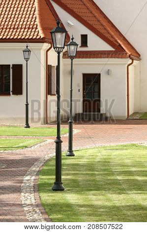 Landscaped oldtown back yard with lawn and stone walkway