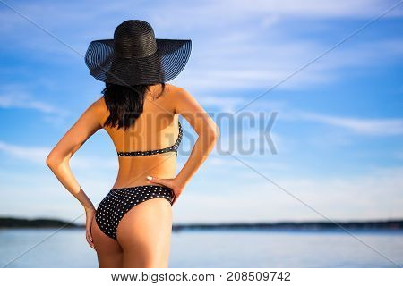 Summer Concept - Rear View Of Slim Woman In Bikini Posing On The Beach