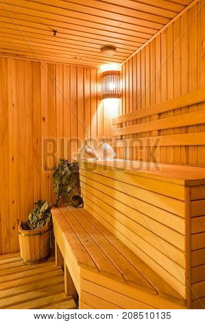 Interior of a sauna . Advantage for health. Oak brooms for a steam room in traditional russian wooden bath.
