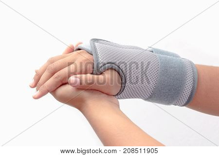 Woman's Hand With Wrist Orthosis On White Background