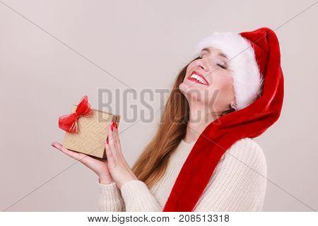 Woman Holding Gift Box. Christmas Time