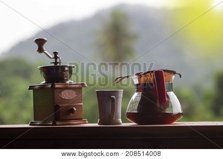 Coffee Grinder With Black Coffee On Wooden