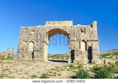 Arch Of Caracalla In Roman Ruins, Ancient Roman City Of Volubilis. Morocco