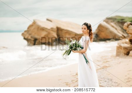 Young Bride On A Sandy Beach