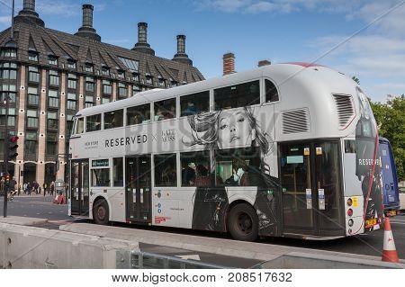 Westminster Bridge, London-September 6,2017: Public traffic white double decker bus on Westminster bridge on September 6, 2017 in London United Kingdom