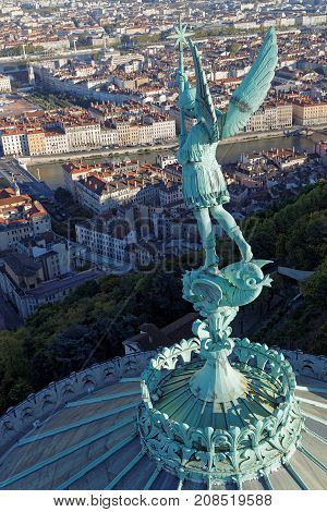 Lyon, France, October 11, 2017 : Angel Gabriel Statue On The Top Of The Basilica Of Fourviere. This