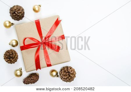 Christmas Holidays Background. Gift Box With Red Ribbon, Fir And Golden Ball On White Background Wit