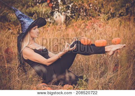 Laughing Girl In Witch Costume Practicing Yoga