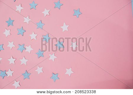 star sprinkles on pink. Festive holiday background. Celebration concept. Top view, flat lay. Horizontal