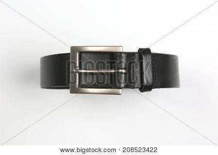 the black leather belt on white background