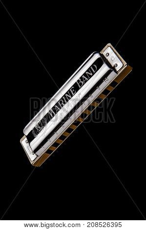 SAINT-PETERSBURG, RUSSIA, OCTOBER 12, 2017: Harmonica Hohner Isolated on Black Background