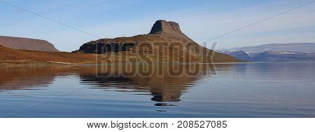 Coastal landscape in Vestfirdir Iceland. Mountain mirroring in the Hestfjoerdur.