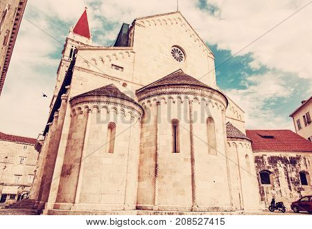 The Cathedral of St. Lawrence is a roman catholic triple-naved basilica constructed in romanesque-gothic in Trogir Croatia. Religious architecture. Travel destination. Red photo filter.