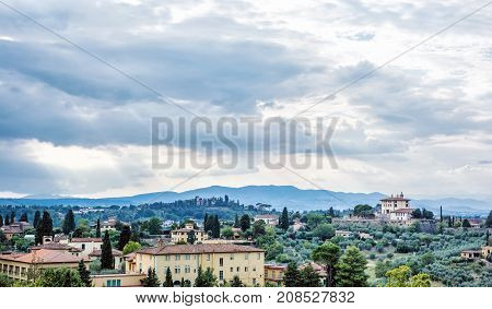 Beautiful Tuscan country. Rural scene. Travel destination. Houses cypress trees and clouds. Beautiful place.