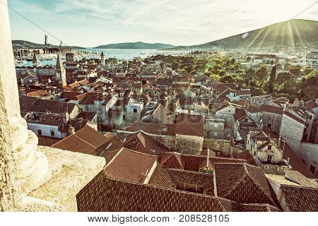 Historic town Trogir from Cathedral of St. Lawrence Unesco Croatia sunset scene. Travel destination. Architectural scene. Summer vacation. Old photo filter.