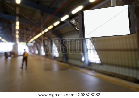 CCTV and LCD TV with white blank screen or billboard copy space for advertising or media and content with blurred image of subway or sky train station commercial and marketing concept