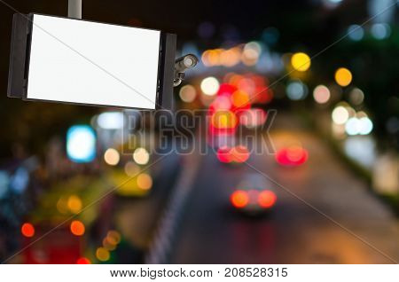 CCTV and LCD TV with white blank screen or billboard copy space for advertising or media and content with blurred image of street traffic light in the city at nigh commercial and marketing concept