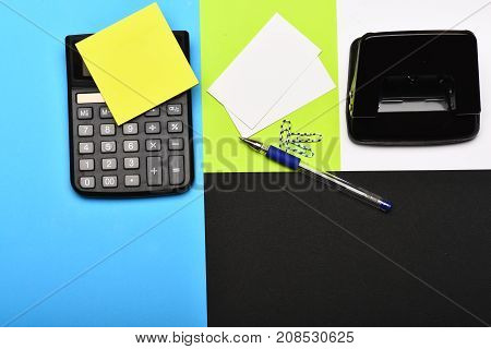 Calculator And Stationery Isolated On Colourful Background