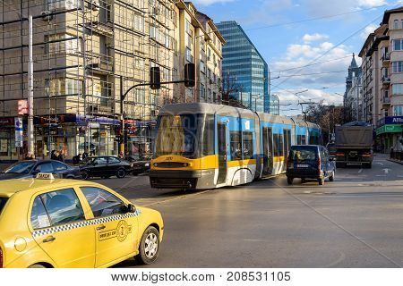 SOFIA, BULGARIA - March 3, 2017 : Modern tram taxi and another cars at busy street in Sofia during rush hour