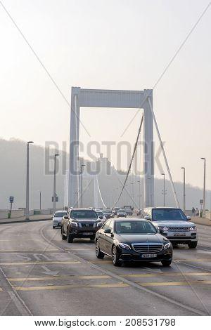 BUDAPEST, HUNGARY - January 02, 2017 : Luxury cars and Elizabeth bridge