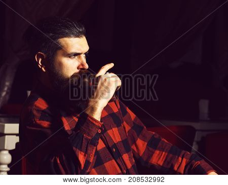 Bearded Man Hipster Holding Glass Of Whiskey In Checkered Shirt