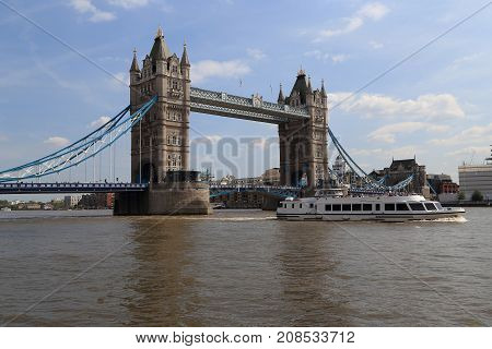 LONDON, GREAT BRITAIN - MAY 16, 2014: The Tower Bridge is a drawbridge over the River Thames which is one of the symbols of London and Britain.