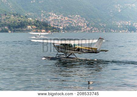 Como Italy - May 27 2016: A seaplane Cessna R172K Hawk XP II of the Aero Club Como taxiing on Como lake in Como City Italy.
