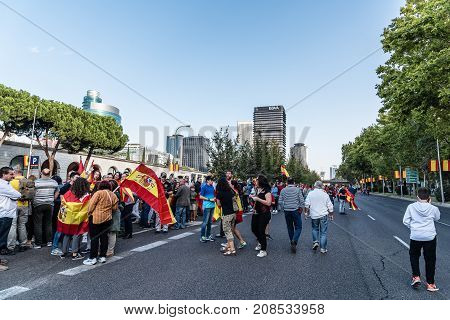 Madrid Spain - October 12 2017: A crowd of people with flags in Spanish National Day Parade. Several troops take part in the army parade for Spain's National Day.