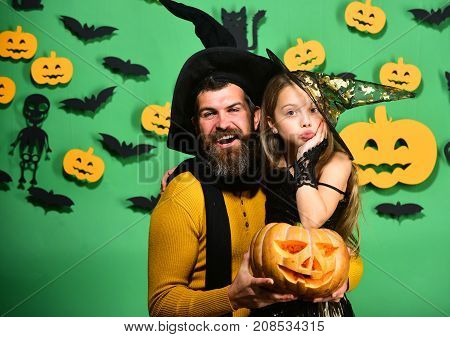 Girl And Bearded Man With Flirty Faces On Green Background