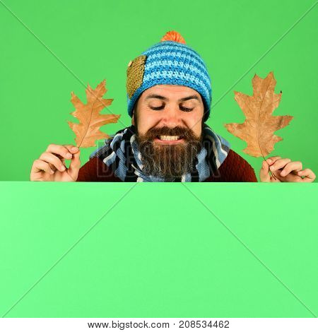Hipster And Excited Face Looks Down Wearing Warm Clothes