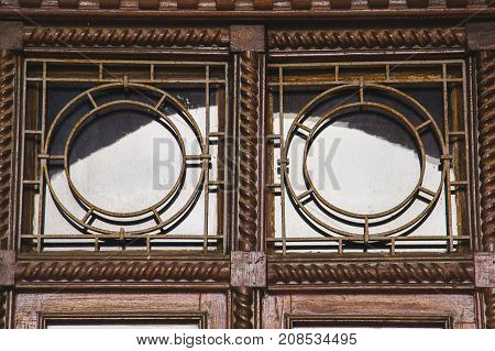 Old wooden windows with metal bars reflection of the sky