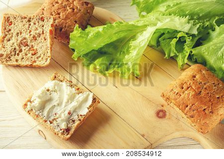 bun with cheese and lettuce close up