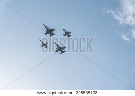 Madrid Spain - October 12 2017: Two F18 Hornet and two F5 jet fighters flying in Spanish National Day Parade. Several troops take part in the army parade for Spain's National Day.