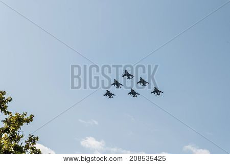 Madrid Spain - October 12 2017: Six Harrier EAV-8B jet fighters flying in Spanish National Day Parade. Several troops take part in the army parade for Spain's National Day.