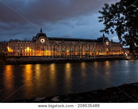 Musee D'Orsay at night on the Seine River in Paris, France