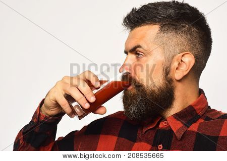Man With Beard Drinks Tomato Juice Isolated On White Background