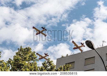 Madrid Spain - October 12 2017: Canadair firefighter aircrafts in Spanish National Day Parade. Several troops take part in the army parade for Spain's National Day.