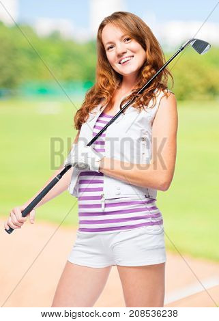 Vertical Portrait Of A Golf Player With A Golf Club On A Background Of Golf Courses
