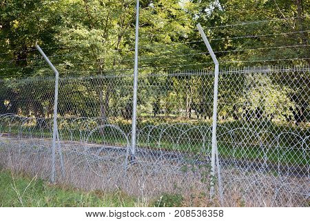 Metal Fence With Barbed Wire. Fortification, Secured Property, Separation Concept. Prison Barrier. S