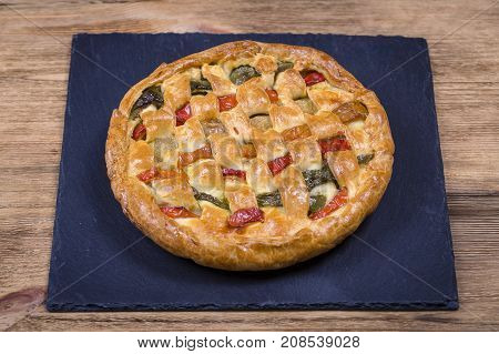 Homemade Organic Chicken Pie With Vegetables To Eat On The Black Slate
