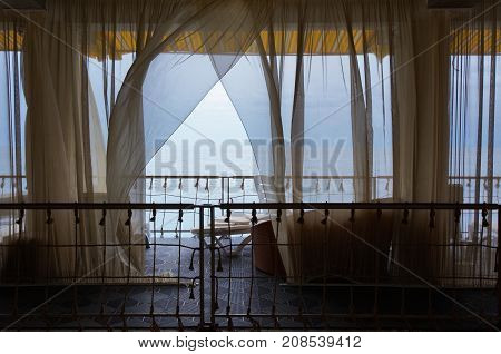Seaview Restaurant Interior. White Terrace Or Veranda With Separated Cabins Under Tent And White Curtains.