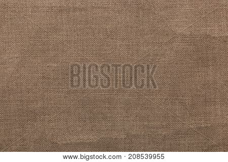 Burlap background and texture The texture of the burlap closeup with yellow tint