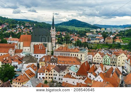 Czech krumlov. Medieval city and the river Vltava. Red tile and narrow streets. Houses made of stone. Medieval houses. Church of St. Vitus the Czech Republic