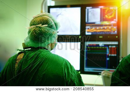 Surgeon Doctor With Coronary Monitor.