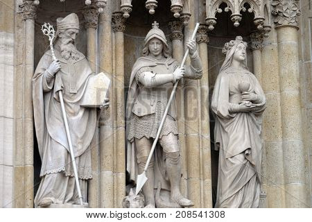 ZAGREB, CROATIA - NOV 29: Statue of Saints Methodius, George and Barbara  on the portal of the cathedral dedicated to the Assumption of Mary in Zagreb on Nov 29, 2014