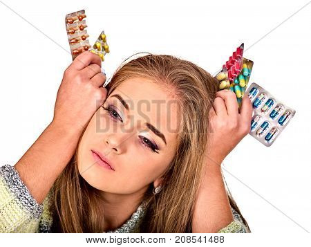 Woman holding remedy, packaging pill and tablet. Colds and flu as well as other diseases injurious to health and are cause of headache. Poor immunity.