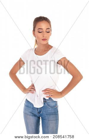 casual blonde woman with blonde hair looks down on white background
